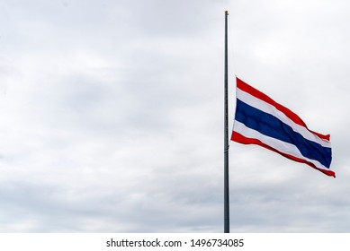 Thailand flag waving at half mast on windy day. Flag flown at half staff. As a sign of honor, respect and mourning for a person who has just died. Copy space.