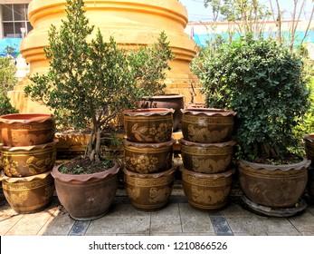 Thailand flowerpot which has design Chinese dragon and flower on flowerpot.