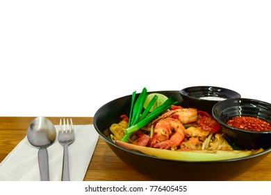 "Thailand food Style Fried Noodles and shrimp ""Pad Thai"" with shrimp and vegetables in black dish isolated on white background.food/drink."