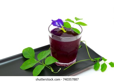 Thailand fresh healthy herbal beverage An-chan juice with lemon juice (butterfly pea flower)on white background