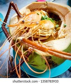 Thailand, Hatyai April,04 2019 - Prawn Tomyam Coconut at local night market.
