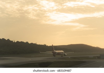 THAILAND - July 17 2017: Air Asia aircraft  airlines is waiting for take off in Phuket international airport with sunset