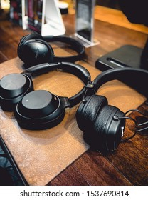 Thailand - June 18 2019: Sony, Marshall & Bose Bluetooth Headphone on wooden table