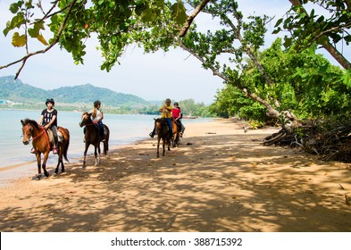 THAILAND, KARBI, FEBRUARY 24 2016.Tourists riding rented horses along the Ao Nang  beach Krabi  ,Thailand on February 24,2016