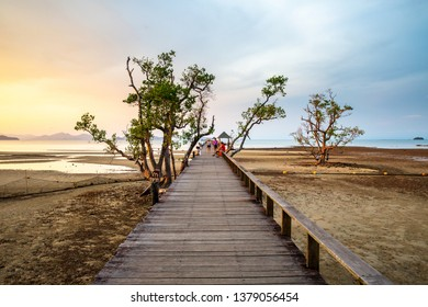 Thailand, Koh Mak island, Trat, Sunday 14 April 2019 : Tourists are waiting to see Sunset on the pier wooden bridge at Ao Tan beach in Koh Mak island