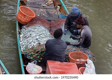 Thailand, Koh Phangan - February 10, 2020: fishing scow is full of nets and herring catch.