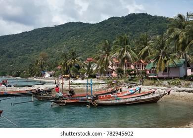 Thailand, Koh Phangan (Phangan Island), local wooden fishing boats in the shore