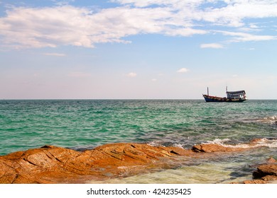 Thailand Koh Samet Old Style Ship near Rocky shore