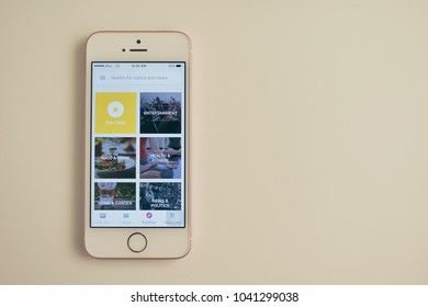Thailand - March 08, 2018 : Smartphone on white table show display of Google Play Newsstand Application on mobile for check news update on Google News.