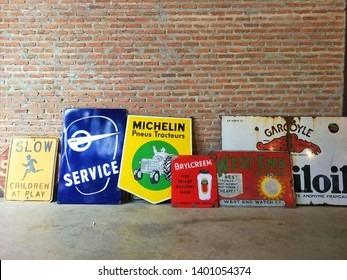 Thailand -March 24, 2019 :  Vintage Advertising Metal on Brick Wall, Jatujak Market of Bangkok, Vintage Market, Second Hand