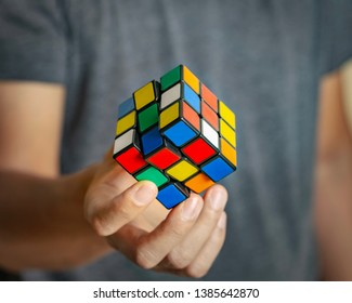 Thailand - May 30, 2019: Rubik's cube in the hands close up. It was invented by Hungarian architect Erno Rubik in 1974.