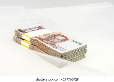 Thailand money banknotes stacked isolated  with bride veil