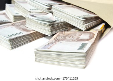 Thailand money bills stacked, baht currency in bag ,Stacks of one hundred dollars banknotes close-up isolated on white, rich and wealth background, business investment.