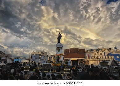 Thailand, Nakhon Ratchasima, Thao Suranaree Monument - On October 27, 2016 at 18:30 PM: The ceremony to commemorate King Bhumibol Adulyadej. Rainbow in the sky