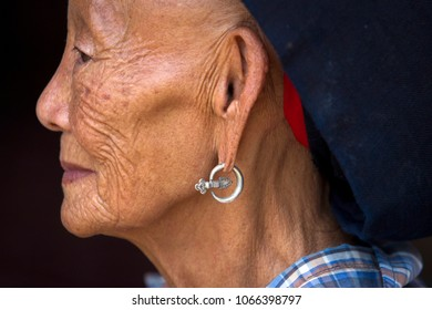Thailand, Nan Province,2018 March 30,  Old wrinkles woman tribal at northen of thailand show handmade silver earring couple in traditional costumes