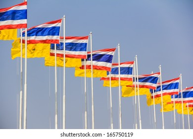 Thailand nation flag and King Rama IX flag in the wind