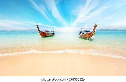 Thailand nature landscape. Sandy beach and travel boats on coast of tropical island near Phuket