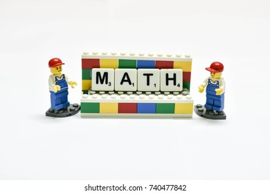 Thailand, October, 2017. The studio shot of the boy and girl mini figure of Lego show the MATH word on board, the Lego is the famous plastics toy for kids.