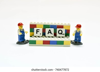 Thailand, October, 2017. The studio shot of the boy and girl mini figure of Lego show the FAQ word on board, the Lego is the famous plastics toy for kids.