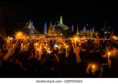 ฺBangkok/ Thailand - October 22nd 2016 - Thai people get together in front of the palace to sing Thai Royal Anthem as a memorial to the beloved King