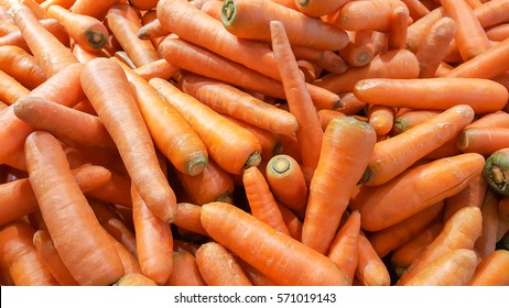 Thailand organic carrots background.Stack of fresh carrots at the market and popular cooking vegetable or fruit