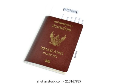 Thailand passport with air ticket in the middle