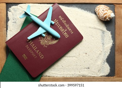 Thailand passport with blue color jet plane toy model put on sand surface represent the tourism and travel industry concept related idea.