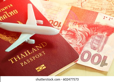 Thailand passport with blue color jet plane toy model put on map surface represent the tourism and travel industry concept related idea.