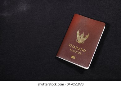 Thailand passport book on black backgrounds