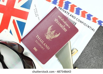 Thailand passport and document bag represent the tourism and travel industry concept related idea. In the scene appear the chinese text on a piece of paper meaning of for official use only.