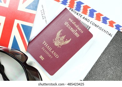 Thailand passport and document plastic bag represent the tourism and travel industry concept related idea. In the scene appear the chinese text on a piece of paper meaning of for official use only.