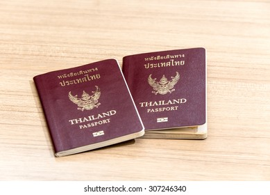Thailand passport isolated an laminate flooring background.