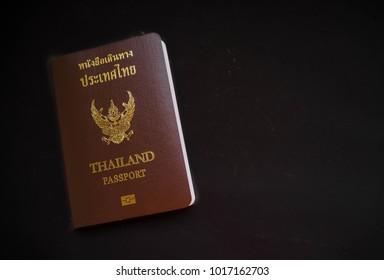 Thailand passport isolated on black background