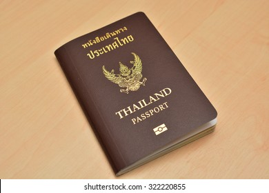 Thailand passport isolated on Wood background