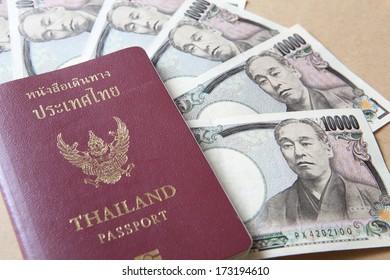 Thailand passport and Japanese Yen money