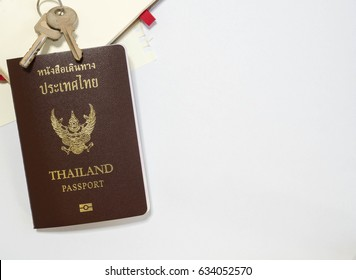 Thailand passport, keys and note with white space.