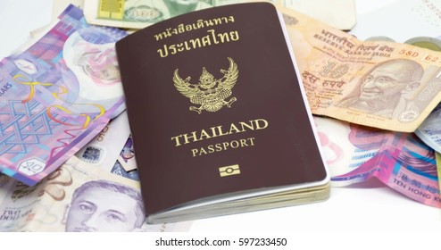 Thailand passport and mouney for travel on the world