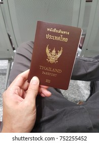 Thailand passport on the hand in traveling time