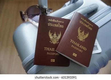 thailand passport on suitcase