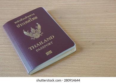 thailand passport on wood table