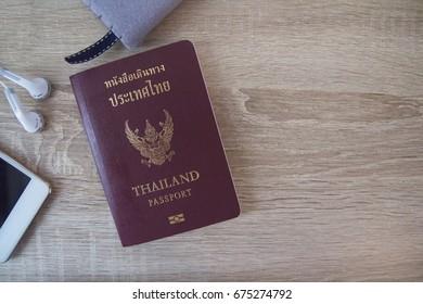 Thailand Passport on wooden table