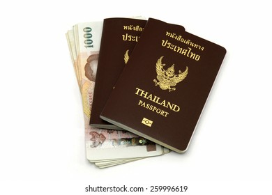 Thailand passport and Thai money isolated on white background