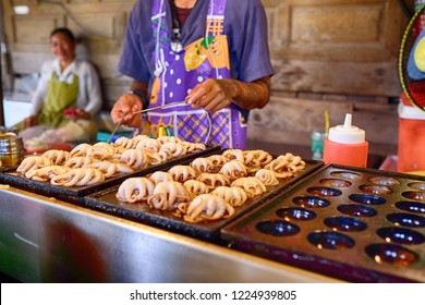 Thailand, Pattaya - September, 2018 :  various local food selling at the floating village Pattaya, Thailand. One of the main tourist spot in Pattaya