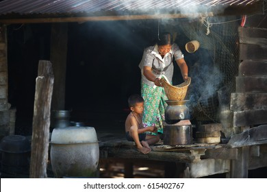 thailand people, mom and son cooking in rural house,Thailand,