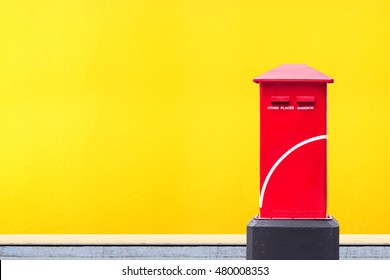 Thailand post box on yellow wall background