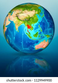 Thailand in red on model of planet Earth on reflective blue surface. 3D illustration. Elements of this image furnished by NASA.