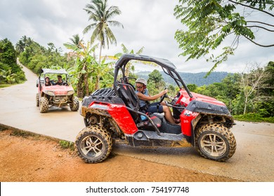 Thailand, Samui, 1 June 2016: Buggy tour in the jungle. Extreme ride on ATV, buggies, jeeps. Extreme quad biking. Jeep in the jungle, forest / ATV, UTV . in motion.