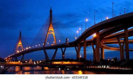THAILAND, SAMUT PRAKAN, OCT 20 1016, Illuminated bridge construction with car transport. Bhumibol Bridge at night, Samut Prakan Province, Thailand. Sunset over a big bridge.