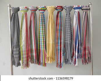 Thailand style loincloth fabric, traditional loincloth made from Thailand cotton hang on stainless steal hanging cloth or clothes line. Multi color and pattern ex. grid, stripe, checkers table.
