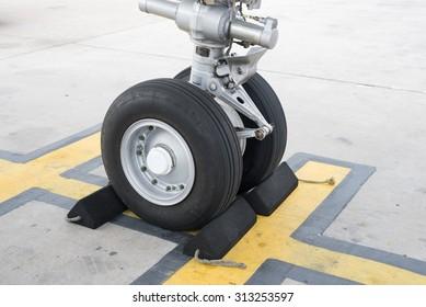Thailand - Suvarnabhumi Airport June 16, 2015: Airbus A320 Aircraft Wheel parking at Suvarnabhumi Airport. Selective focus at Wheel
